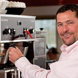 Employee getting coffee from coffee machine