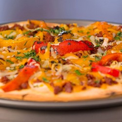 A pizza with peppers