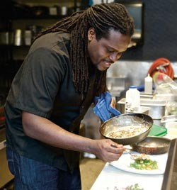 A chef making a plate of food