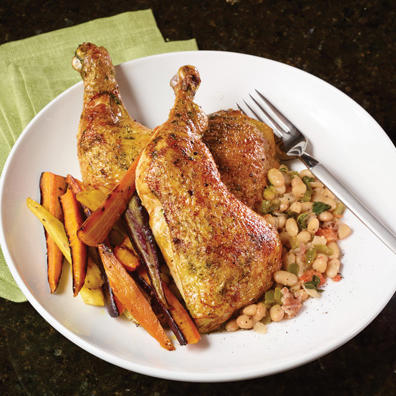 Baked chicken leg with sweet potato fries and beans